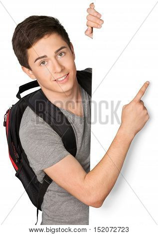 Portrait of Student behind Blank Wall Pointing Finger