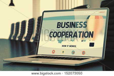 Modern Meeting Hall with Laptop on Foreground Showing Landing Page with Text Business Cooperation. Closeup View. Toned Image. Selective Focus. 3D Render.