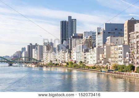 Tokyo skyline along sumida river Japan