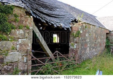 A dilapidated farmhouse which has fallen into ruins