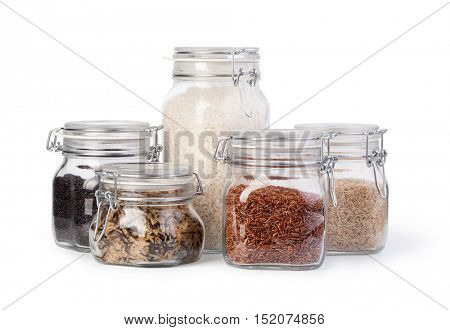 Raw rice in a jar isolated on white.
