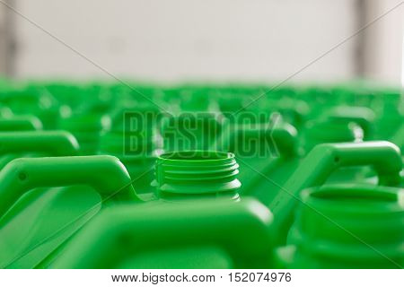 Empty plastic cans green color for liquids. Concept: Manufacturing