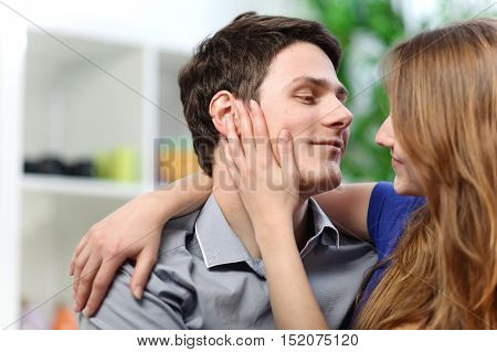 Pretty Woman Stroking The Cheek Of Her Boyfriend With Love