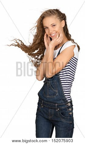 Friendly Young Girl in Overalls with Hands on Face - Isolated