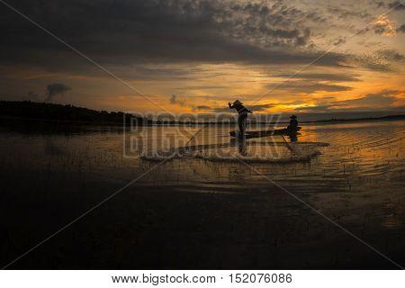 Fisherman fishing on a river fishing boat Thailand.