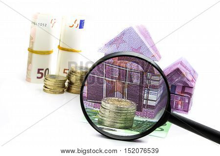 Euro Bill House And Expenses Under Magnifying Glass