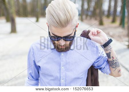 Fashionable Hipster In Park