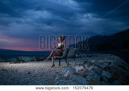 Woman With Wine On Evening Beach