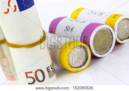 closeup on euro notes and roll coins