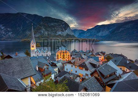 Hallstatt, Austria. Image of famous alpine village Hallstatt during autumn sunrise.
