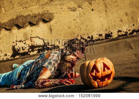Zombie Man Crawls For Pumpkin