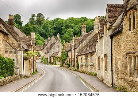 Narrow streets through houses in Castle Combe Village in Wiltshire, England.