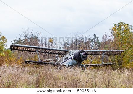 Old broken burned russian airplane on the field