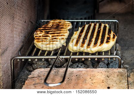 Making Of Pita Bread On Barbecue Grill Over Hot Coal.