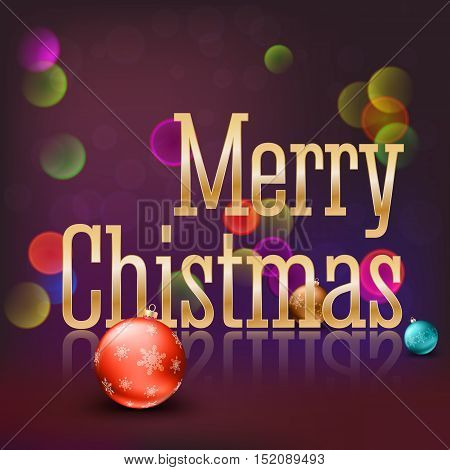 Greeting card with a big golden inscription Merry Christmas and color Christmas balls with snowflakes on a magical bokeh background with flares and glowing. Template for your greeting cards