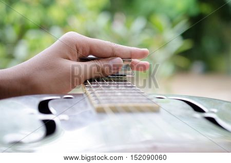 Expert Musician plays a Dobro GuitarClassic Dobro guitar played my a master