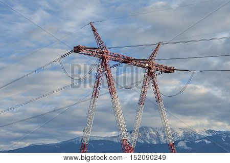 High voltage transmission tower post. International electrical power line view.