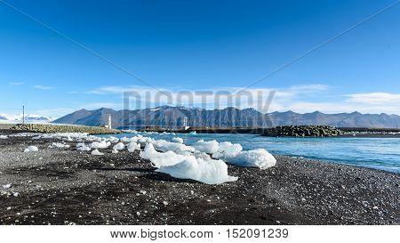 Beautiful view of icebergs in Jokulsarlon glacier lagoon Iceland; selective focus