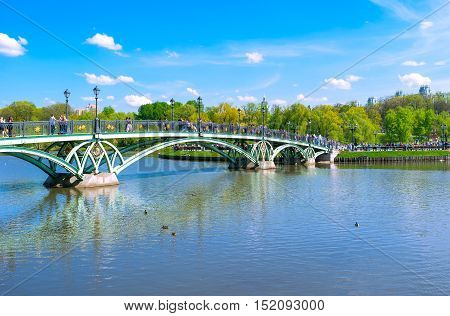 MOSCOW RUSSIA - MAY 10 2015: The East arch bridge leads to the Catherine's Island in Tsaritsyno Park the popular place for rest among locals and tourists on May 10 in Moscow.