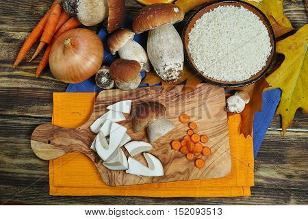 Cooking risotto with wild mushrooms boletus porcini