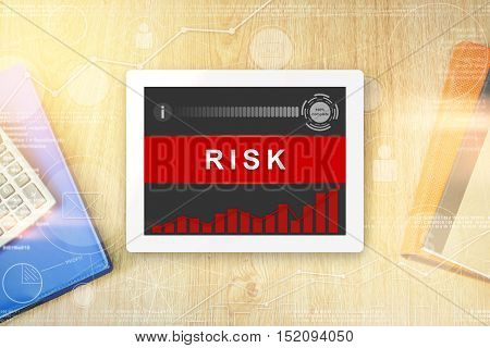 risk word on tablet with soft light vintage effect