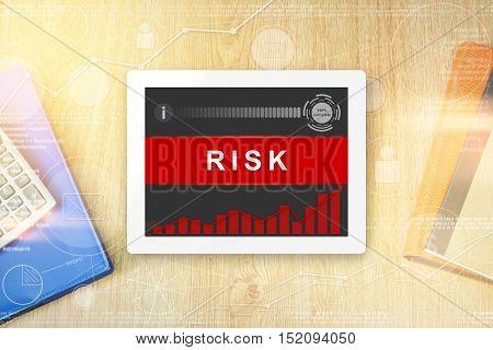 risk word on tablet with soft light vintage effect