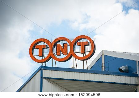 VILNIUS, LITHUANIA - AUGUST 7, 2016: TNT logo sign on a facade.TNT Express is an international courier delivery services company with headquarters in Hoofddorp, Netherlands.