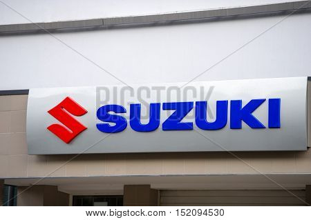 VILNIUS, LITHUANIA - AUGUST 7, 2016: Suzuki dealership logo. Suzuki is a Japanese multinational corporation specializing in manufacturing automobiles, four-wheel drive vehicles, motorcycles.