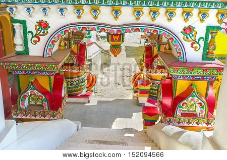 The beautiful porch with th figured pillars fretwork painted ornamentations and complex patterns Izmailovsky Kremlin Moscow Russia.