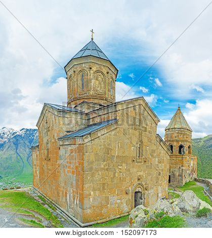 The wall of Tsminda Sameba (Holy Trinity) Church is the medieval stone church with carved decors and gate chapel located at the foot of Kazbek Mount Gergeti Georgia.