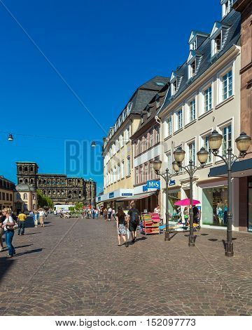 Trier, Germany - April 7, 2008:  Tourists Walk Along Simeon Strasse