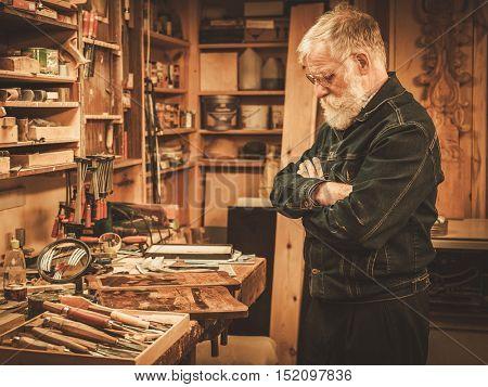 Senior restorer in his workshop.