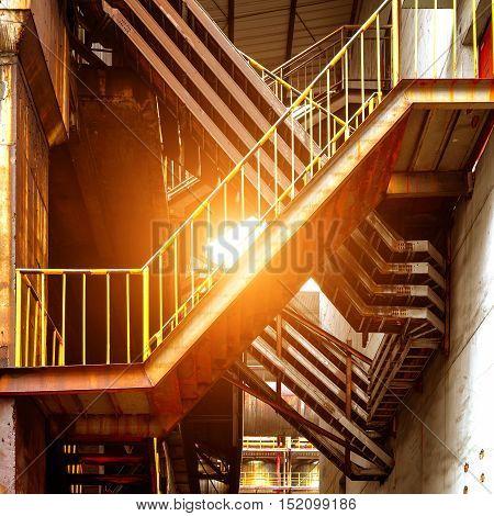 Inside metal stairs dusk landscape large steel mills.
