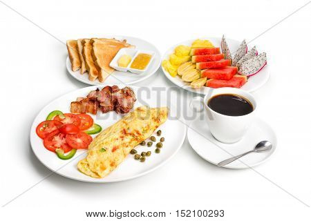 Omelette with Bacon Slices stack and vegetables, fruit salad, Toast and cup of coffee, isolated On White Background