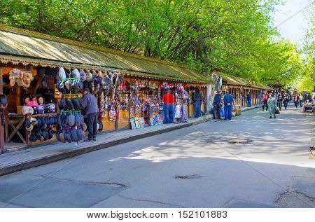 MOSCOW RUSSIA - MAY 10 2015: The wooden stalls of Izmailovsky market with the wide range of souvenirs art and craft goods antiques and others on May 10 in Moscow.