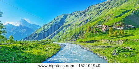 The picturesque mountain Snostskali river runs along the villages and pastures of the Sno gorge and flowing into Terek Kazbegi Georgia.