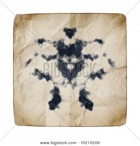 An image of an old paper with Rorschach graphic