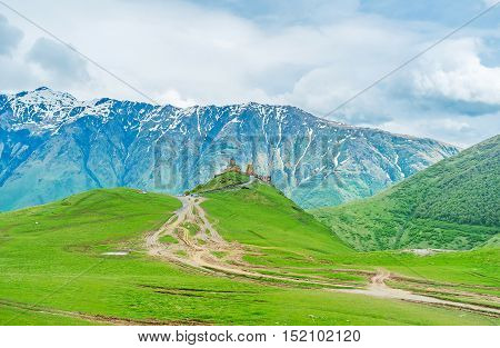 The climb from resort in valley to Gergeti Trinity Church in montains is one of the main tourist attractions in Stepantsminda Kazbegi National Park Georgia.