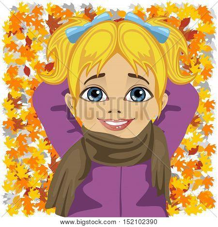little cute girl lying on autumn leaves