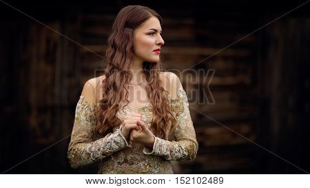 Thoughtful young woman looking for someone. Fantasy fashion idea. Long Time Coming.