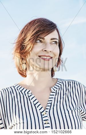 Portrait of young caucasian woman in sunny outdoor. Beauty and fashion. Vertical composition. Positive emotions. Retro photo filter.