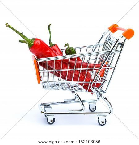 mini shopping cart full with chilli pepper isolated on white background