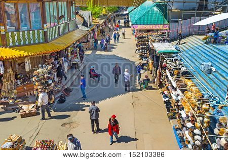 MOSCOW RUSSIA - MAY 10 2015: The row of Izmailovsky Market with the stalls offering the various fur hats popular among tourists on May 10 in Moscow.