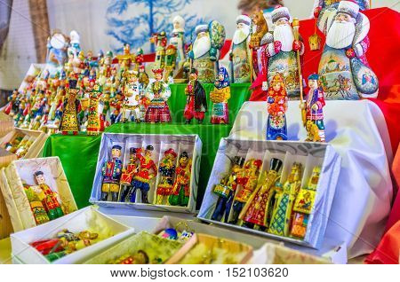 The handmade and painted wooden Christmas toys in historic dress in the stall of Izmailovsky market Moscow Russia.