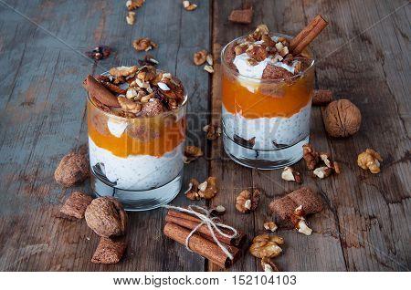 Chia seeds creamy pumpkin spicy pudding with cinnamon and walnuts. Healthy vegetarian seasonal meal.