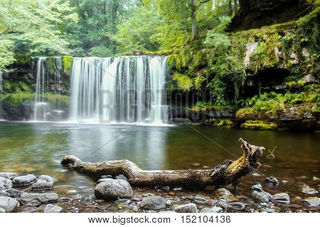 forest waterfall on a mountain river in Wales, United Kingdom, England
