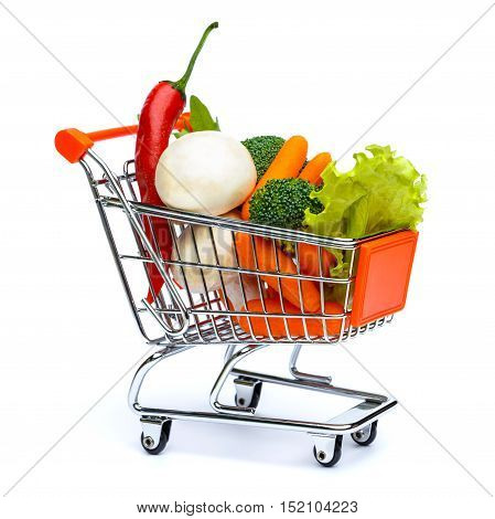 mini shopping cart full with vegetables isolated on white background