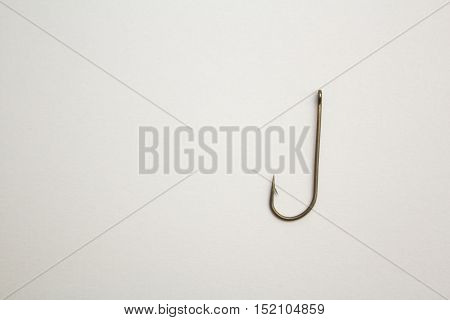 Fishing Hook On A White Paper Background