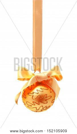 Hunging golden christmas ball isolated on a white background