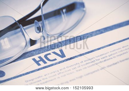 HCV - Hepatitis C - Medicine Concept with Blurred Text and Spectacles on Blue Background. Selective Focus. 3D Rendering.